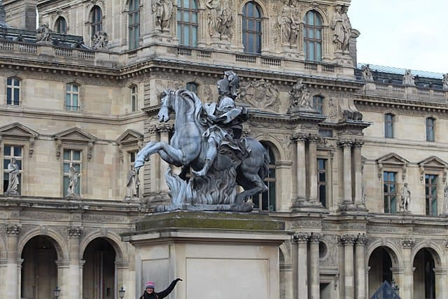 Statue honoring Louis XIV as seen today outside of the Louvre