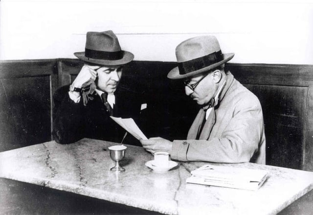 Fernando Pessoa (right) with Costa Brochado at Café Martinho da Arcada, Praça do Comércio, Lisbon.