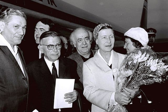 Simone de Beauvoir, left with flowers