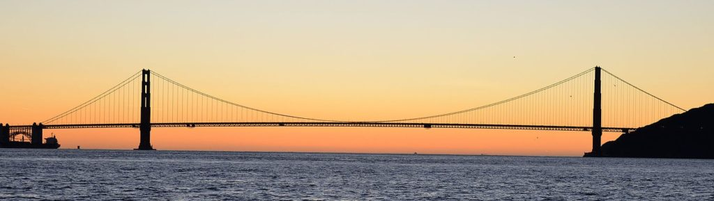 Sunset on the Golden Gate Bridge and the Pacific Ocean beyond